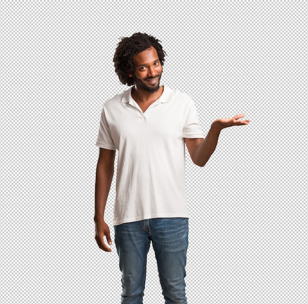 Handsome african american holding something with hands