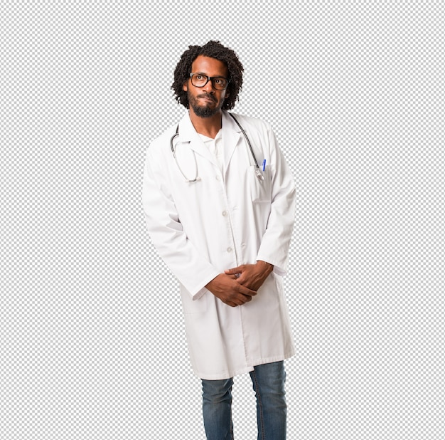 Handsome african american medical doctor doubting and confused