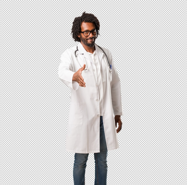 Handsome african american medical doctor reaching out to greet someone or gesturing to hel