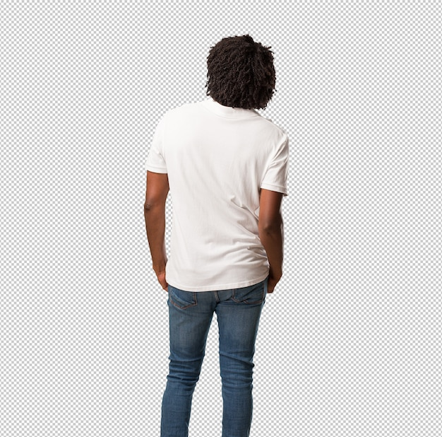 Handsome african american showing back, posing and waiting, looking back