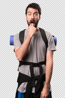 Handsome backpacker making vomiting gesture