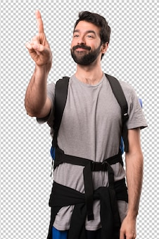 Handsome backpacker touching on transparent screen
