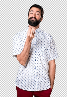 Handsome brunette man with beard making money gesture