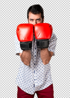 Handsome brunette man with beard with boxing gloves