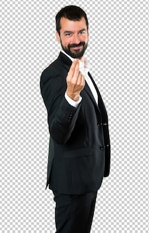 Handsome businessman making money gesture