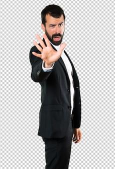 Handsome businessman making stop sign