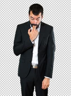 Handsome businessman making vomiting gesture
