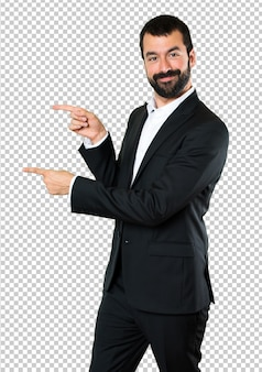 Handsome businessman pointing to the lateral