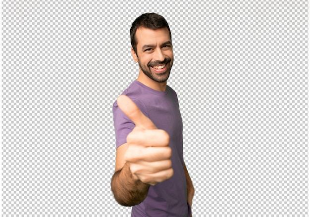 Handsome man giving a thumbs up gesture because something good has happened