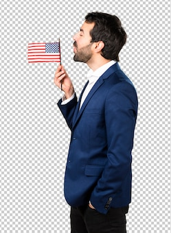 Handsome man holding an american flag
