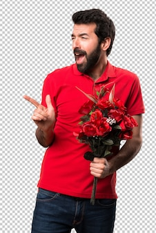 Handsome man holding flowers dancing