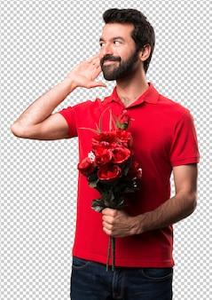 Handsome man holding flowers listening something