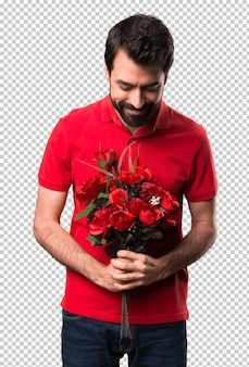 Handsome man holding flowers looking down
