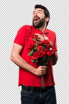 Handsome man holding flowers in love