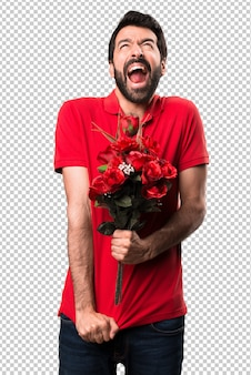 Handsome man holding flowers shouting