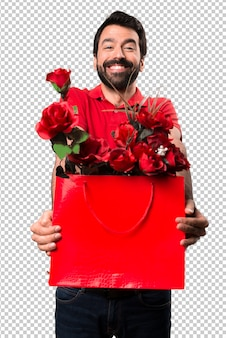 Handsome man holding flowers