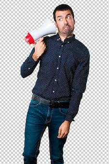 Handsome man holding a megaphone