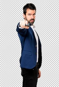 Handsome man holding a pistol