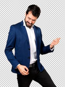 Handsome man making guitar gesture
