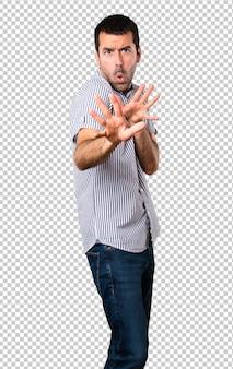 Handsome man making no gesture
