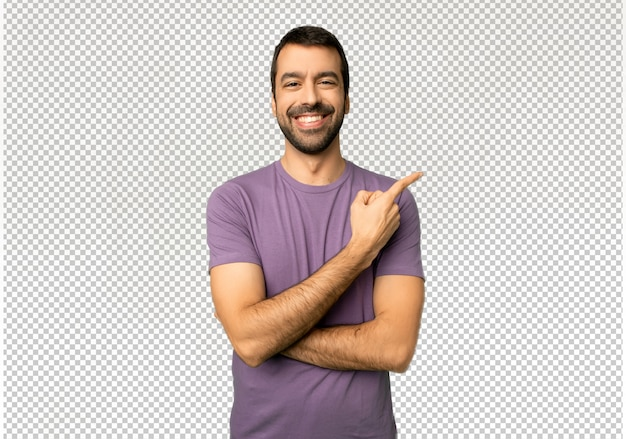 Handsome man pointing to the side to present a product