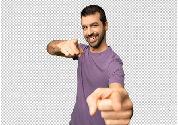 Handsome man points finger at you while smiling