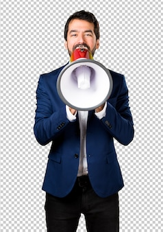 Handsome man shouting by megaphone