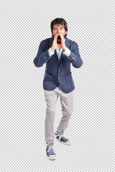 Handsome man shouting over isolated white background