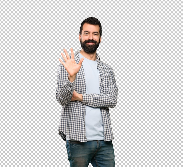 Handsome man with beard counting five with fingers