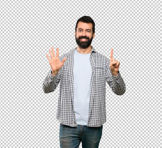 指で6を数えるひげを持つハンサムな男