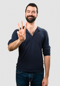 Handsome man with beard counting three