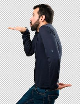 Handsome man with beard dancing
