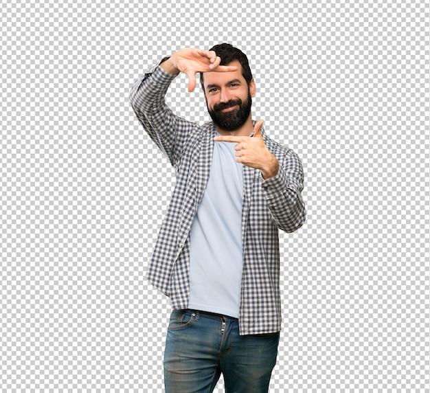 Handsome man with beard focusing face. framing symbol