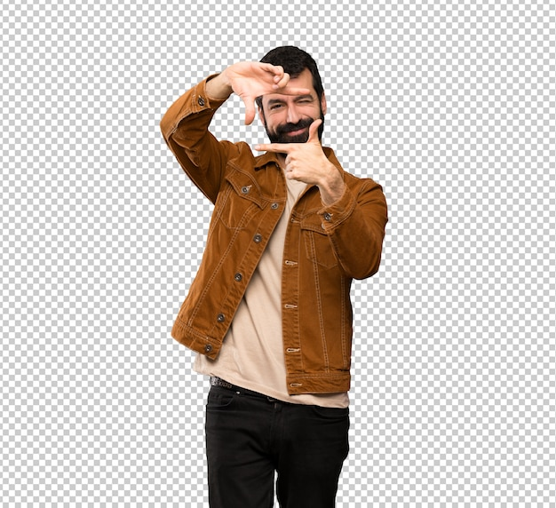 Handsome man with beard focusing face. framing symbol
