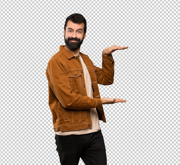 Handsome man with beard holding copyspace to insert an ad