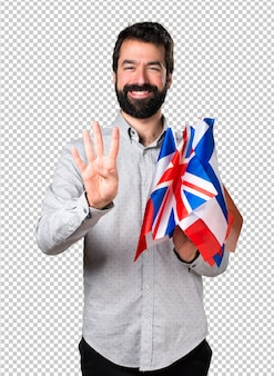 Handsome man with beard holding many flags and counting four