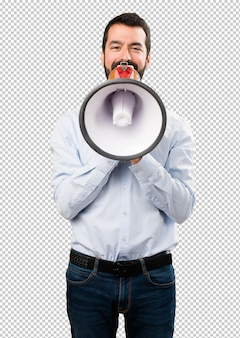 Handsome man with beard holding a megaphone