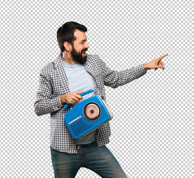 Handsome man with beard holding a radio