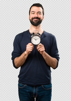 Handsome man with beard holding vintage clock