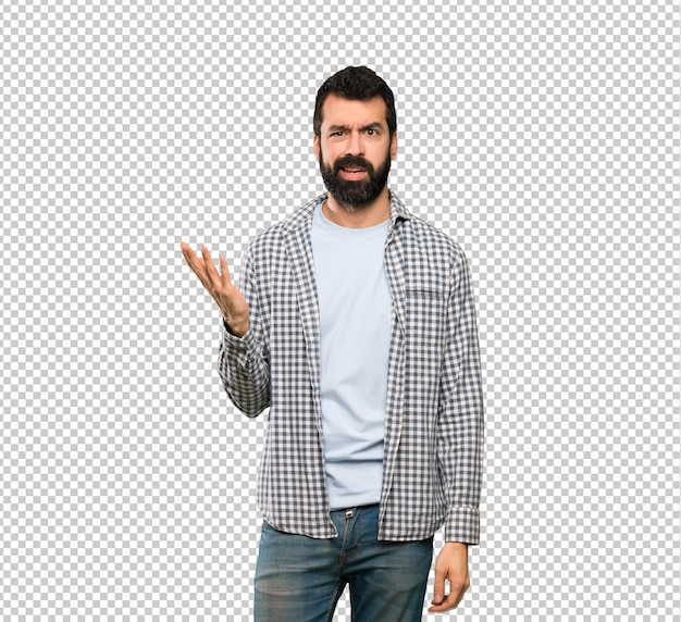 Handsome man with beard making doubts gesture