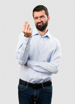 Handsome man with beard making money gesture