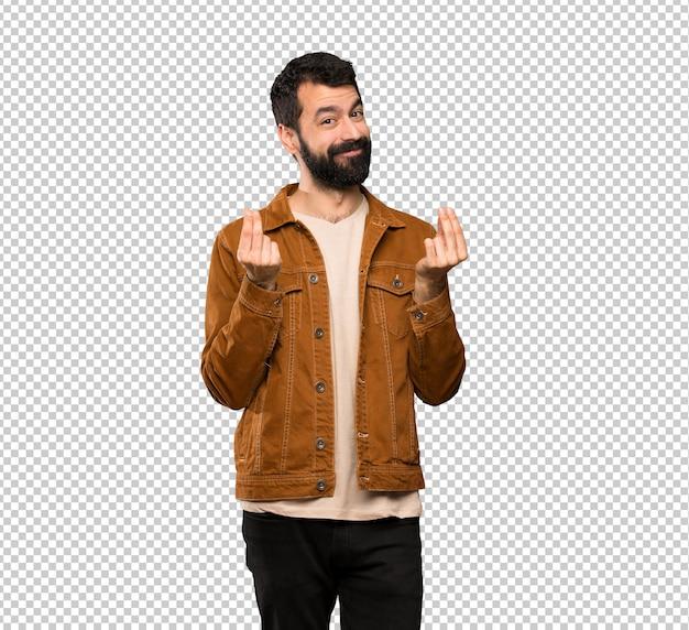 Handsome man with beard making money gesture