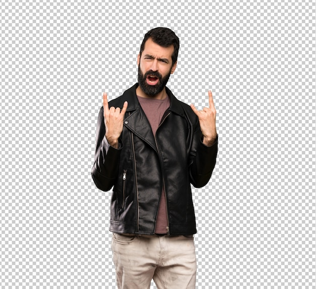 Handsome man with beard making rock gesture