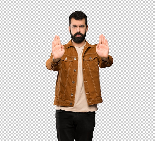 Handsome man with beard making stop gesture and disappointed