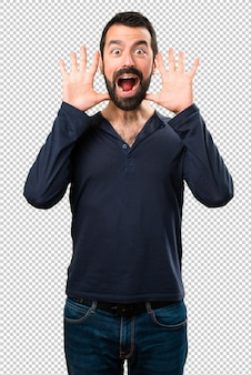 Handsome man with beard making surprise gesture