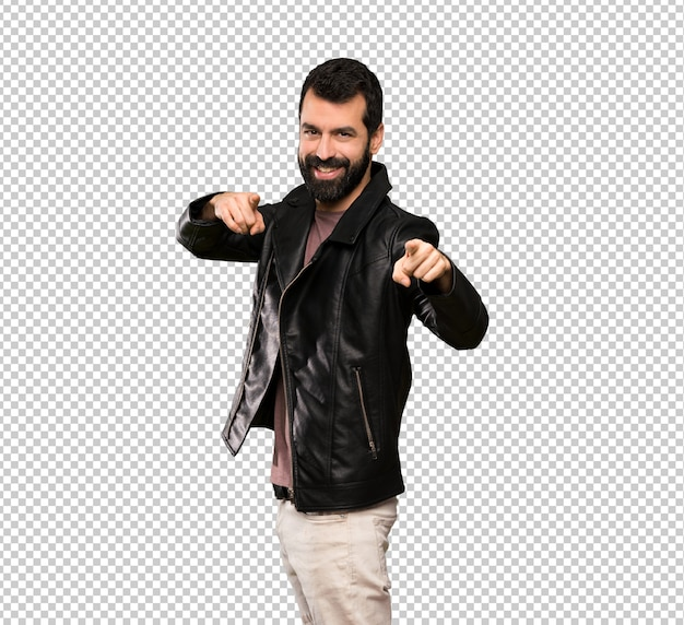 Handsome man with beard points finger at you while smiling
