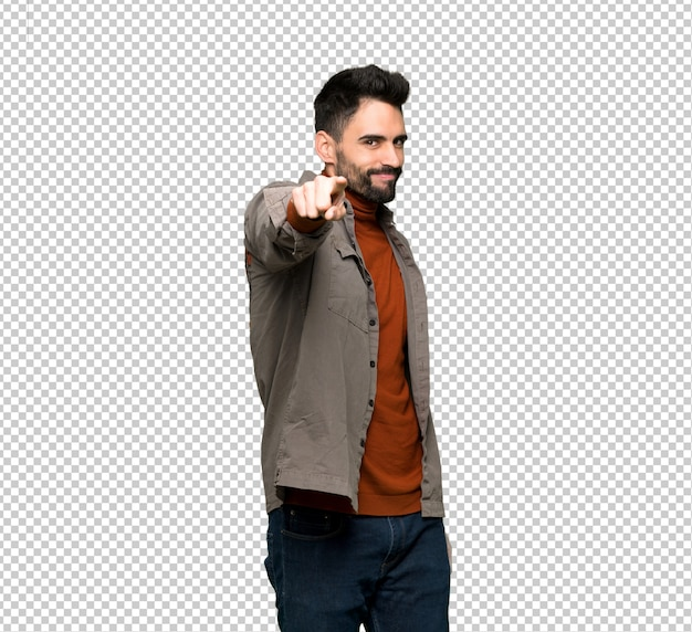 Handsome man with beard points finger at you with a confident expression