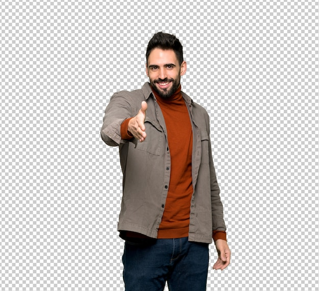 Красивый мужчина с бородой пожимает руку за заключение хорошей сделки
