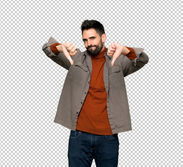 Handsome man with beard showing thumb down with both hands