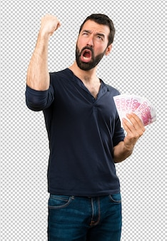Handsome man with beard taking a lot of money